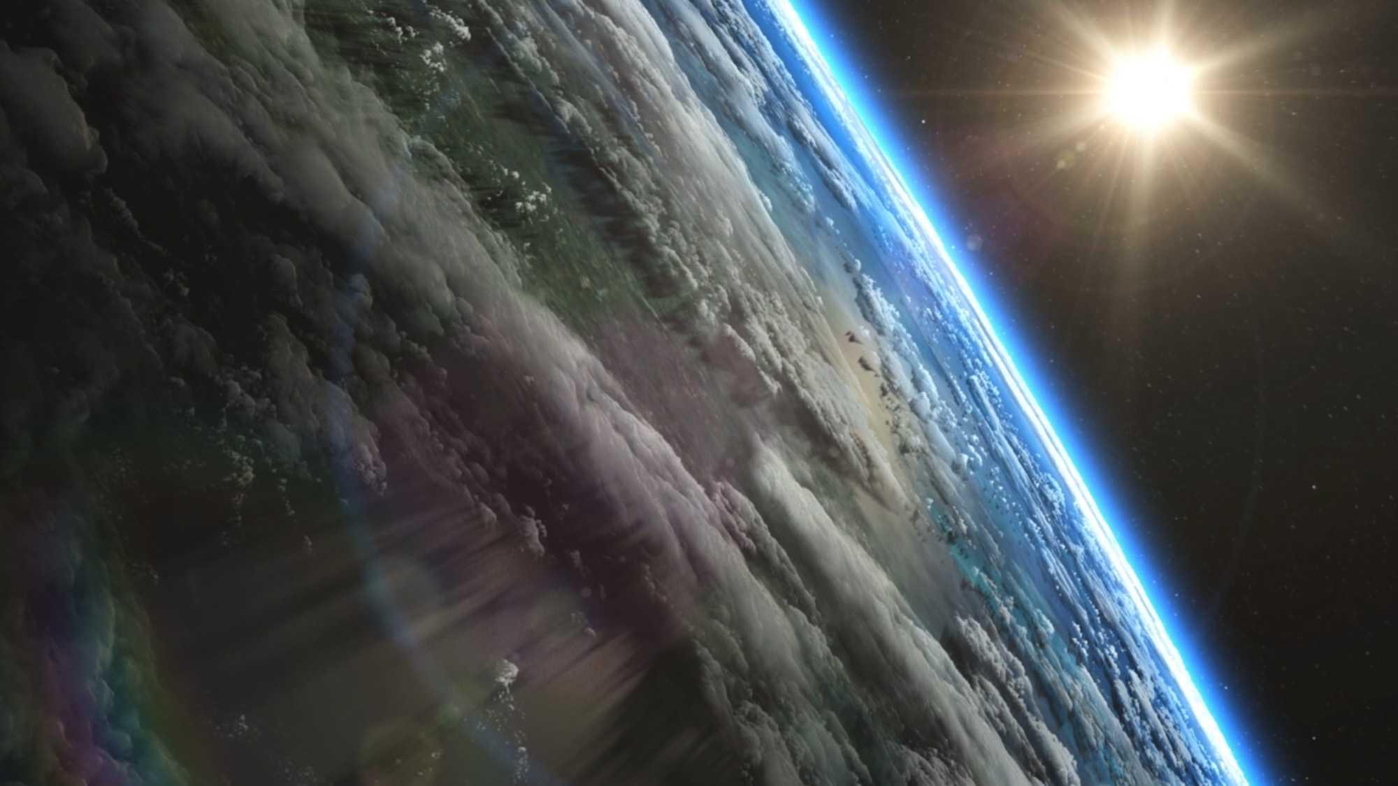 Das Bild zeigt eine Weltraumaufnahme der Erde. Es sind einzelne Länder sowie Wolken zu erkennen. Am Horizont leuchtet die Erdatmosphäre. Die rechte Ecke des Bildes zeigt die Sonne, sie scheint. Das Bild dient als Making Of Bild für den Portfolioeintrag Munich Aerospace Imagefilm von Panda Pictures.