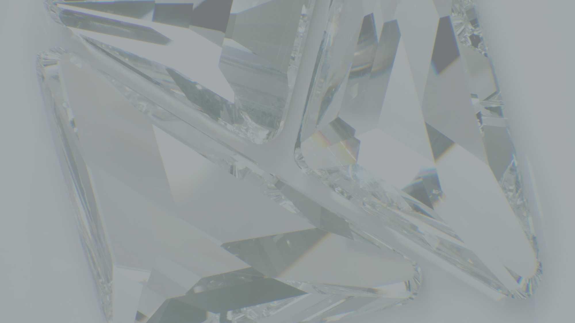 Das Bild zeigt einen Edelstein. Dieser ist vergrößert zu sehen. Das Bild ist grau eingefärbt. Das Bild dient als Quote Field Bild für den Portfolioeintrag Swarovski Produktfilm von Panda Pictures.
