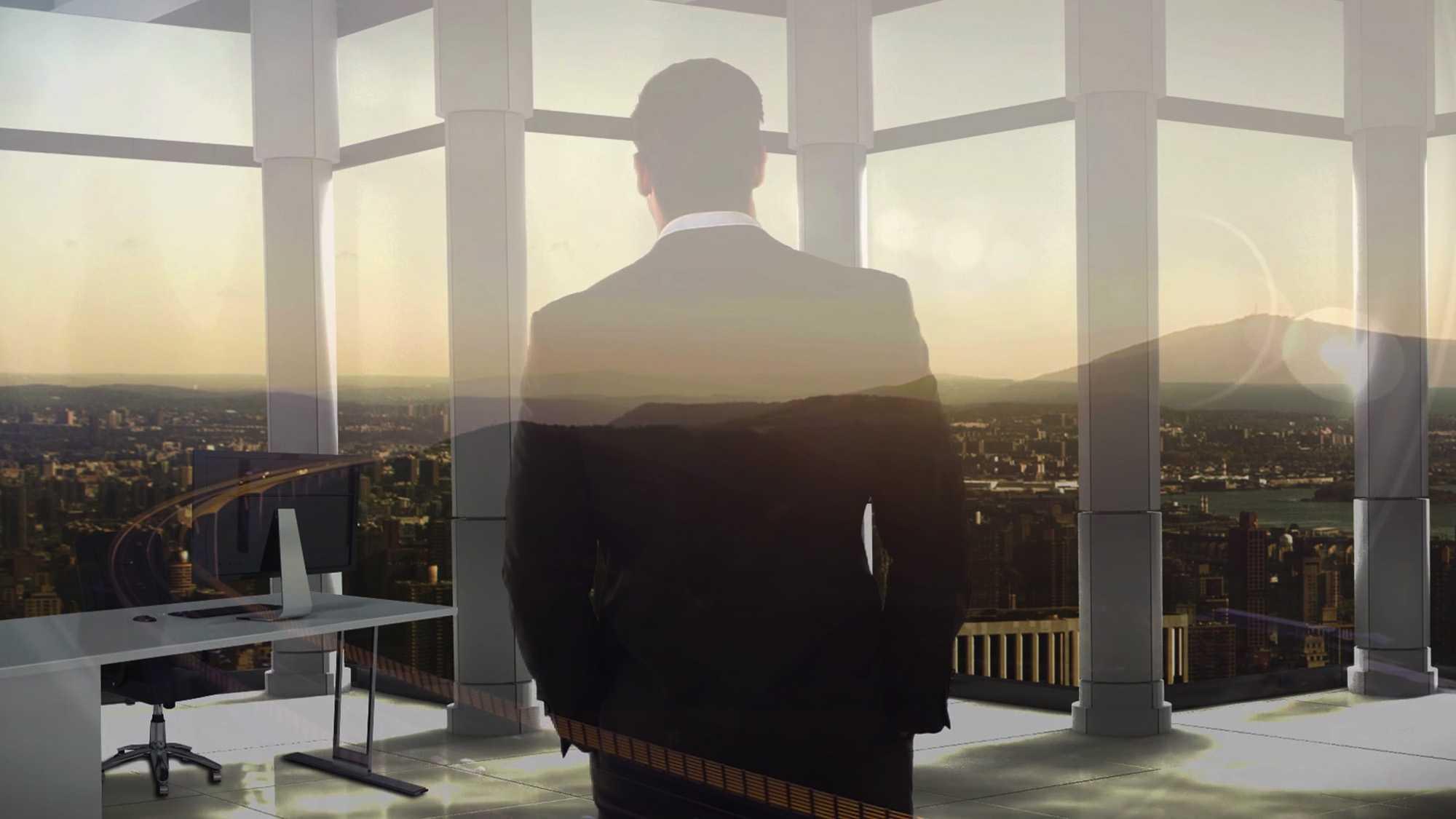 Das Bild zeigt eine Rückenansicht eines Mannes. Er trägt einen schwarzen Anzug. Er steht vor einem Fenster. Das Bild dient als Sliderbild für den Portfolioeintrag SupplyOn - Supply Chain Management Imagefilm von Panda Pictures.